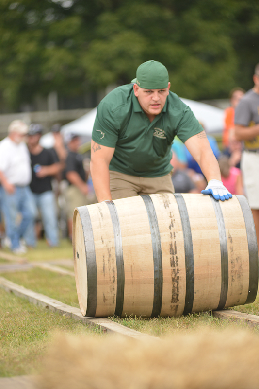 The annual barrel relay is far harder than you can imagine. Filled with water, each 500 pound barrel must be maneuvered against the clock, and positioned perfectly (bung up) in the rick.