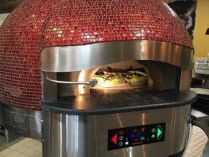 Rosenberg's eventual play toy: the pizza oven at Noosh Nosh. | Photo by Steve Coomes