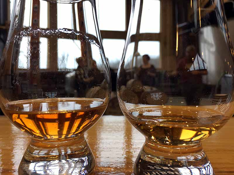 The glass on the left came from the smaller barrel, and the depth of amber color is noticable. | Photo by Steve Coomes