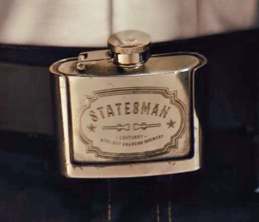 In the movie, Statesman members wear belt buckle flasks filled with, presumably, Statesman Bourbon.