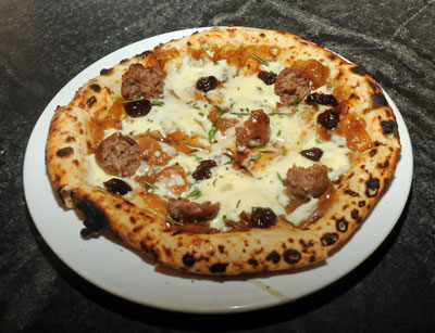 The sweet onion marmalade pizza with sausage, bourbon-infused cherries and fresh-chopped rosemary.